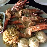 Tiger prawns in butter garlic with mashed potato, rice and salad