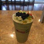 Green tea bubble tea with tapioca pearls and rainbow jelly