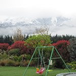 Backyard swings and snowy mountains