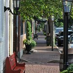 Brick sidewalks and cobblestone street help transport visitors back in time while enjoying shopp
