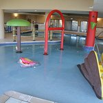 Large pool area - shallow with play features on this end but deeper w/volleyball in the backgrou