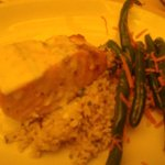 Salmon over rice. Green beans and carrots.