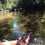 Soaking tired feet in cool river water