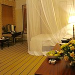 Our deluxe suite at Victoria Falls Hotel, special touches flowers, fruit bowl, chocolates.