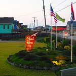 """View of the sign, front lawn, & flags from the """"Crows Nest"""" at dusk"""