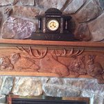 Stone fireplace and mantle carvings of local animals