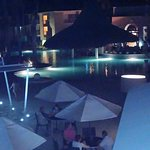 View from upstairs restaurant of pool at night