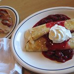 Sweet cream crepes with raspberries and bacon
