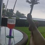 view from lanai with essential feet up, drink at the ready