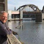 Joe enjoys the October sun and view of the Siuslaw River bridge