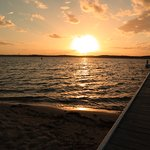 Sunset over jetty, boat hire and jet boat rides available.