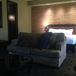 Exposed brick wall, king-size bed, comfy sofa...Room 2202