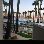GORGEOUS! looking from 2nd floor down to restaurant, pool, and bay at sunset.
