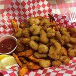 Mound of popcorn shrimp and fried sweet potatoes