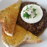 Mince on multigrain toast wit hpoached egg