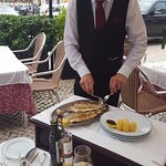 Table service- and a very big sole.