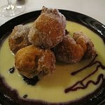 Donuts with Raspberry Jam in a pool of custard!