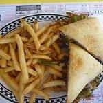 Cheese steak sandwich and fries