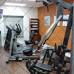 Fitness room, 3 machines plus free weights, etc.