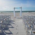 Beach wedding ceremony at Tortuga Beach Resort