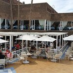 The poolside bar and dining area. The main dining room is seen on the 1st floor.
