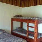 Habitacion triple, cama matrimonial y camarote, incluye baño privado