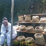 The qilata or host showing us the millenarian Andean products: Dehydrated potatoes, isaño, oca,