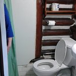 """That toilet seat is about 3"""" from the side wall."""