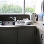 A clean, well-lit and well equipped kitchen with view of the park