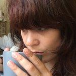 Thoughtfully drinking tea