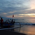 local fishermen heading out as the sun rises