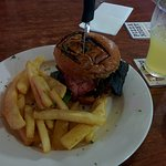 A burger with a pint of cider at Mangrove Jack