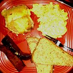 Scrambled eggs with Andouille sausage, cheesy scalloped potatoes and wheat toast