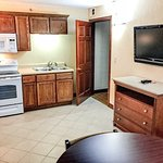 Room 546 is a King suite with a full-sized kitchen which includes a wall-mounted flat screen TV