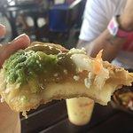 Empanadas con Queso with salsa verde... well, a half eaten one anyway.