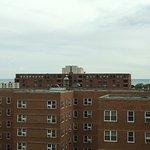 Gloomy day. Lake Michigan viewable in the gap between the buildings.