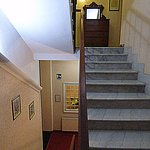 The marble stairway to the first floor - the bar is the other side of the window below.