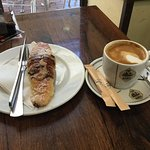 Cappuccino and chocolate croissant.