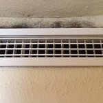 Mould above air con damp and smelly