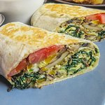 Breakfast burrito with egg and spinach