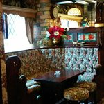 One of the many old fashioned booths you can eat at.