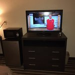 "37"" TV on updated dresser, fridge + microwave"