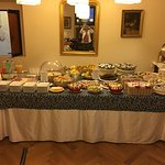 breakfast buffet at the hotel with hot scrambled eggs and cappuccino made to order