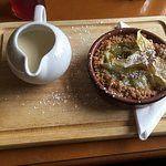 Apple and gooseberry crumble with custard