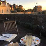 The lovely owner arranged for wine and cheese - sunset over ancient Dinan . A memory I will trea