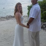 The Bride and Groom on the beach at Surfsong Villa Resort.