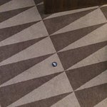 We found a Coca Cola zero bottle cap on carpet, as soon as we checked in :-/