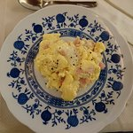 Delicious scrambled eggs with ham and cheese