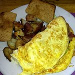 Omelet special (missing avocado), burned potatoes, stale toast