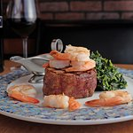 Filet mignon topped with shrimp and sauteed spinach. Incredible